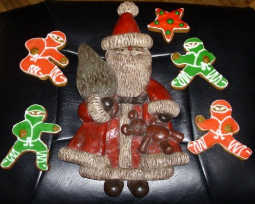 Piped and frosted Ninjabread Cookies. I also made the Santa from salt & flour dough. He is painted and sealed with polyurethane. He's about 20 years old now and still holding up!