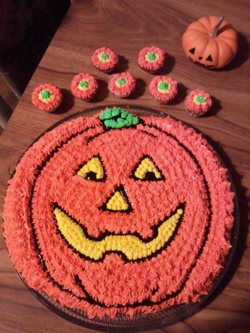 Pumpkin Cake with matching baby cupcakes.