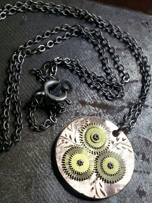 Made a pendant out of a penny, some watch gears and a little etching.